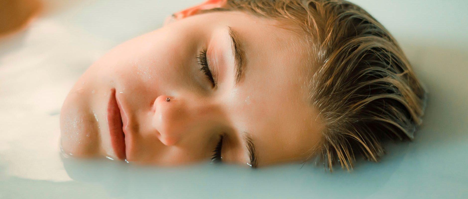 calm woman lying in bathtub